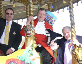Colin Bryan (Managing Director of Drayton Manor), Ken Knowles (Lichfield Town Cryer), and Cllr David S Smith (Leader of Lichfield District Council)