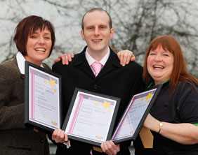 Andrea O'Brien, James Caveen and Julia Day with their Service Awards