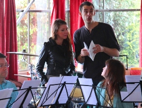 Chris Rolls with actress Rachel Matthews and Amington Band members during rehearsals