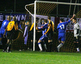 Chasetown bundle the ball home to make it 4-2 against Rushall Olympic. Pic: Dave Birt