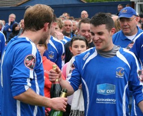 Dave Egan and Dean Perrow share a champagne moment after sealing promotion