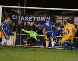 Mansfield Town keeper David Grof fumbles Richard Davies' corner into his own net. Pic: Dave Birt