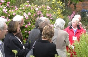 Tour guide Susan Baird leads the group through the herb garden at Erasmus Darwin House