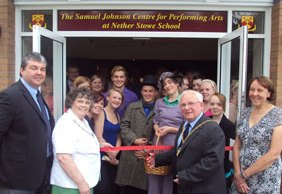 Cllr Brian Bacon cuts the ribbon on the Samuel Johnson Centre for Performing Arts