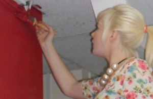 Lauren Moulding paints a wall