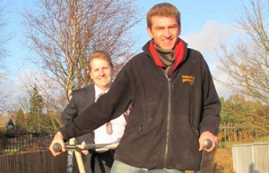Cllr Matthew Ellis and Simon Roberts try some of the new outdoor fitness equipment