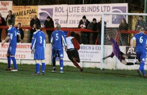 Chasetown goalkeeper Ryan Price can't stop an Ashton United free-kick finding the net. Pic: Dave Birt
