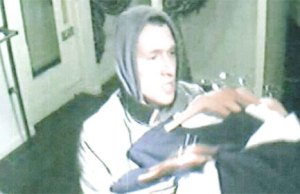 CCTV images of the man burgling Cure on Bore Street in Lichfield