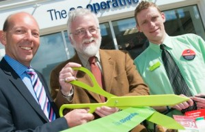 Martyn Cheatle, Cllr Ed Sharkey and store manager Tony Wills cutting the ribbon