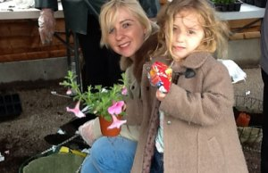 Two Friday Acre residents putting a hanging basket together