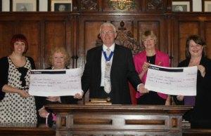 Cllr Bernard Derrick hands over the cheques