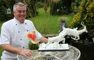 Simon Smith with two of his food sculpture creations