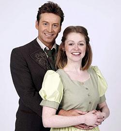 Sophie Randal as Maria and Jordan Adams as Captain Georg von Trapp