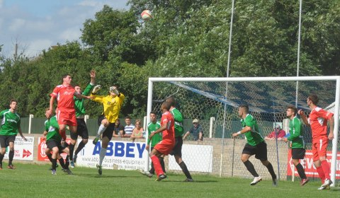Keeper reaches for the ball