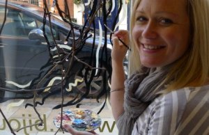 Fay Shoesmith working on one of her window murals