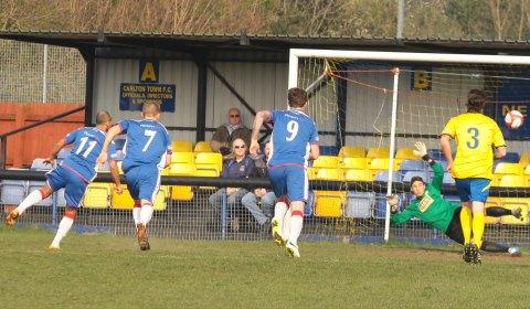Simon Brown fires home the spot kick. Pic: Dave Birt