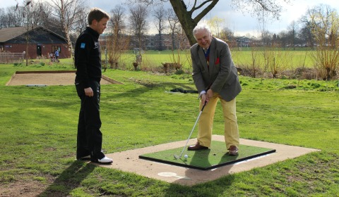 Cllr David Smith gets some advice on his swing