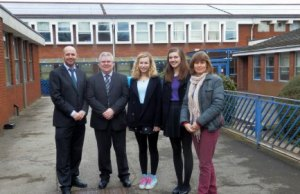 Assistant headteacher Oliver Forster and Henry Exton with Friary School students Alice Arnstein and Emily Townsend, and Kate Sadler from Southern Staffordshire Community Energy in front of the new solar panels