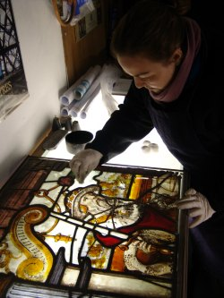 Restoration work is carried out on one of Lichfield Cathedral's glass panels