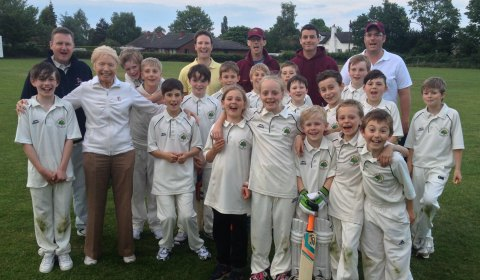 Members of Kings Bromley Cricket Club junior section with Jean Matthews Gough at the club's ground