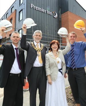 Richard Smith, Cllr David Leytham, Jan Leytham and Mark Greasby outside the new Premier Inn in Lichfield. Pic: Paul Pickard