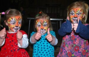 Youngsters show off their face painting at the Big Green Fair