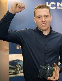Liam Dixon with his award