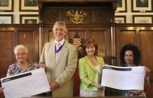 Kathy Peat from Lichfield Arthritis Care and Marie Bright from Lichfield Young Carers receive their cheques from Cllr David Leytham and his wife Jan