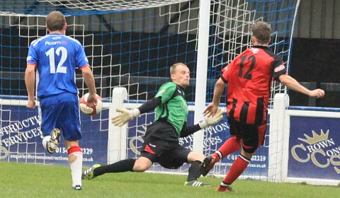 Ashley Grayson makes it 4-0 to complete Chasetown's misery. Pic: Dave Birt