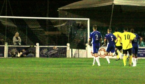 Matthew Lowe scores from the penalty spot for Newcastle. Pic: Dave Birt