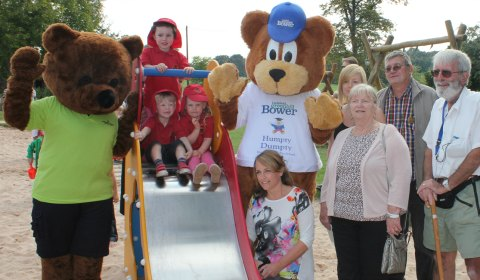 Lichfield Greenhill Bower Committee members join Bower Boswell Bear, Ranger Ted and three toddlers from Humpty Dumpty Day Nursery & Pre-school