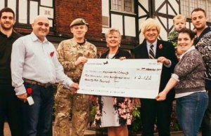 The cheque is handed over the the Mercian Regiment Benevolent Fund