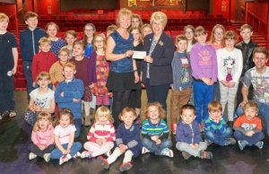 Louise Glynn receives the cheque from Maureen Woodcock, MBE, chairperson of the Friends of the Lichfield Garrick