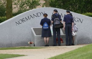 Visitors look at the Normandy Campaign Memorial