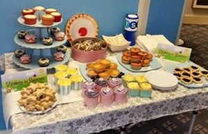 The cakes on sale in the Lichfield branch of TSB in aid of Violets in Bloom