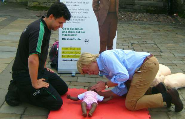 Michael Fabricant MP learning how to give CPR to a baby