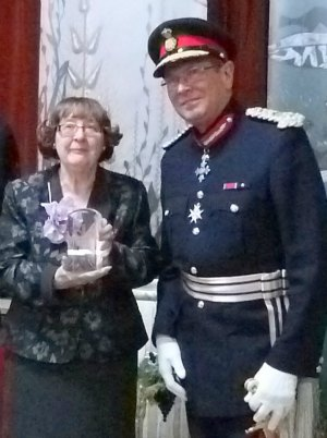Barbara Marshall receives the group's Queen's Award for Voluntary Service