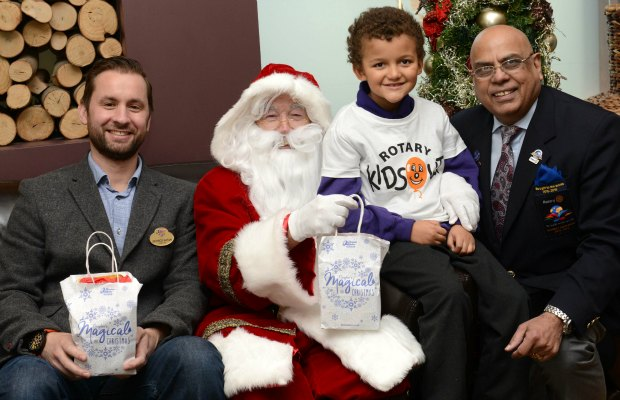 Drayton Manor director George Bryan, Devanti Palmer and Paul Jaspal from Rotary meet Father Christmas