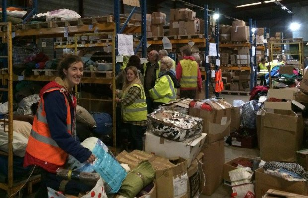 Volunteers sorting clothes and blankets. Pic: Dave Simcox