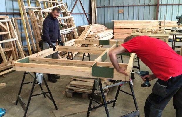 Flat pack buildings being put together by volunteers. Pic: Dave Simcox