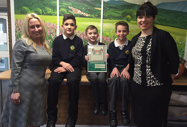 Headteacher Jane Davies, pupils John Cheshire, George Holmes, William Silvester and assistant headteacher Carly Tranter who is also Fulfen Primary School's leader for inclusion