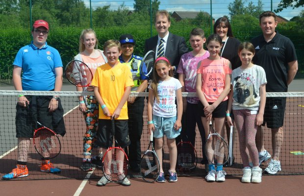 Police and Crime Commissioner Matthew Ellis with youngsters at a Space tennis session