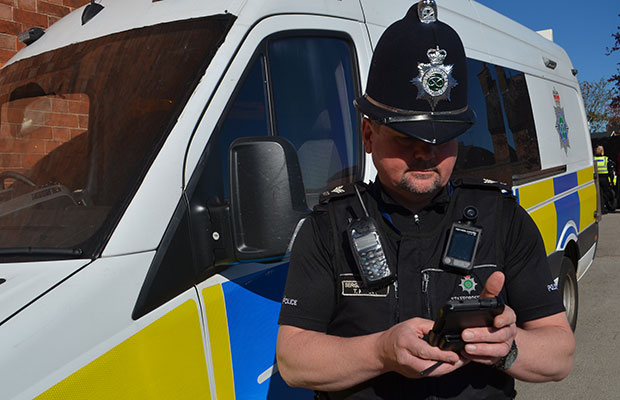 Sgt Tyrone Kerr with one of the new mobile devices issued to officers in Staffordshire