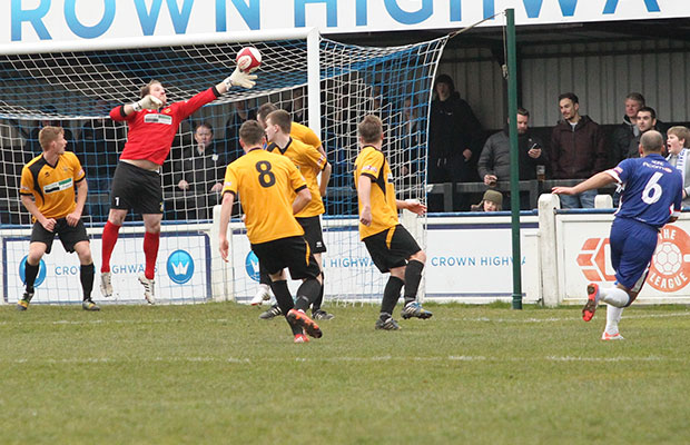 Simon Brown's shot is palmed onto the bar by Chris Martin. Pic: Dave Birt