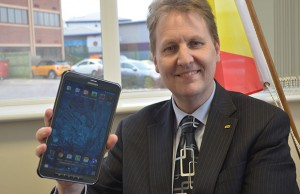 Matthew Ellis with one of the Samsung Galaxy tablets