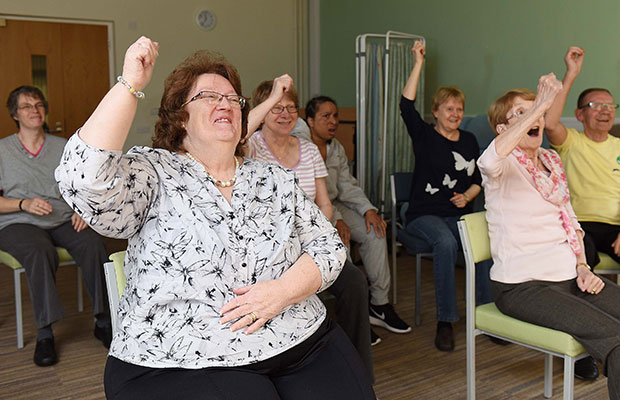 Pat Mason taking part in the seated exercise class at St Giles Hospice