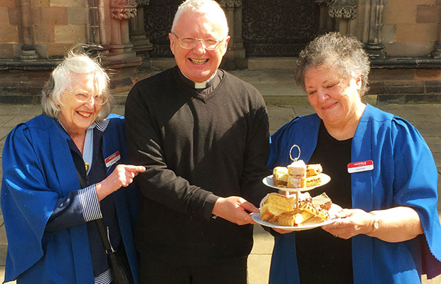 The Very Revd Adrian Dorber, Dean of Lichfield, and two welcomers from the cathedral getting ready for Staffordshire Day