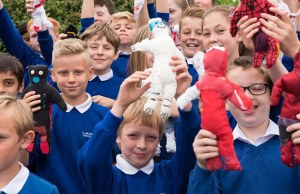 Children from St Michael's Primary School with some of their ragdolls