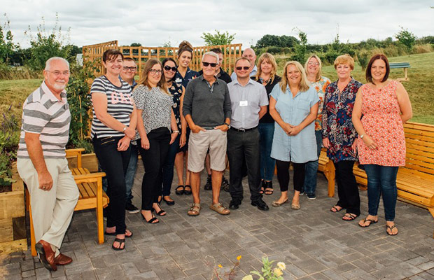 Mike Dolphin with members of the NEC team in the new St Giles Hospice garden