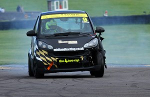 Greg Owens in his damaged Smart Brabus. Pic: MotorV8 Media